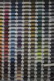 Multi-colored sewing threads. Multi-colored threads stand nearby in coils at the stand Stock Images