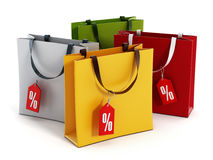 Multi colored shopping bags with sale tags. 3D illustration Stock Images