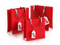 Multi colored shopping bags with sale tags. 3D illustration Stock Photography