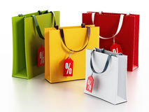 Multi colored shopping bags with sale tags. 3D illustration Stock Photos