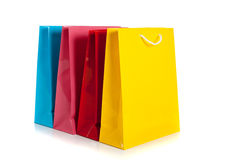 Multi colored shopping bags on a white background Royalty Free Stock Photos