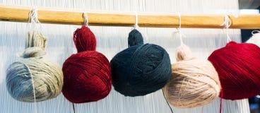 Multi-colored silk thread hanging stock image