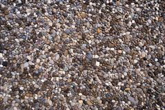 Multi-colored small river pebbles used as paving slabs.  royalty free stock photo