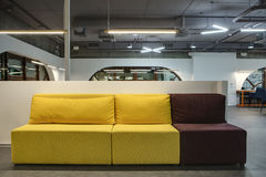Multi-colored sofa in moder interior Stock Photography