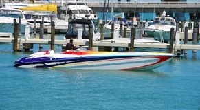 Multi-colored speedboat at doc Stock Image