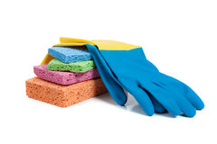 Multi-colored sponges and rubber gloves on white Royalty Free Stock Photography