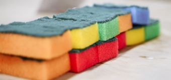 Multi-colored sponges for washing and cleaning lined in a row stock images