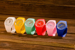 Multi-colored sports watch on a wooden background Stock Photo