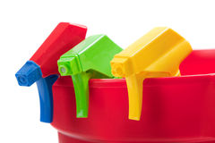 Multi colored spray nozels in a red bucket Stock Photo