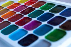 Multi-colored squares paint watercolor close-up as background or design stock image