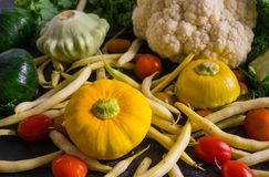 Multi-colored squash, cauliflower, cherry tomatoes and green beans royalty free stock photography