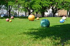 Multi-colored stone spheres lie on a lawn. Braniewo, Poland.  Stock Image