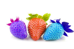 Multi colored strawberries Stock Image