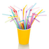 Multi-colored straws for  cocktail in  disposable cup isolated. Royalty Free Stock Photo