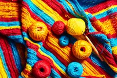 Multi-colored striped crochet, crochet hook and yarn