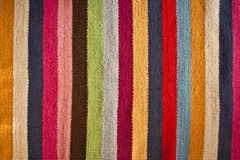 Multi colored stripey woolen rug Stock Photos