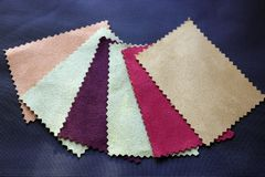 Multi-colored suede flaps on a black background royalty free stock photo