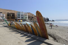 Multi colored surfboards in Cerro Azul beach of Lima Stock Image