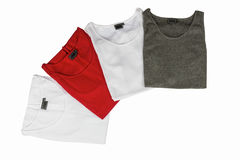 Multi-colored T-shirts for men. Four different colored shirts for men on white - Isolate Royalty Free Stock Photo