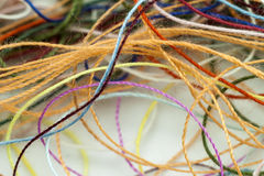 Multi-colored tangled colorful needlecraft silk thread rope. Mac. Ro shot. Abstract colors background Stock Photos