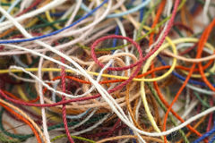 Multi-colored tangled colorful needlecraft silk thread rope. Mac. Ro shot. Abstract colors background Stock Photography