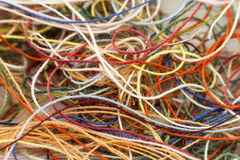 Multi-colored tangled colorful needlecraft silk thread rope. Mac stock images