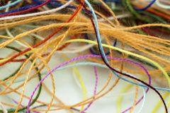 Multi-colored tangled colorful needlecraft silk thread rope. Mac. Ro shot. Abstract colors background Stock Image