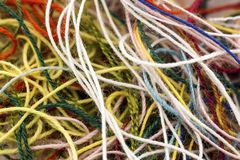 Multi-colored tangled colorful needlecraft silk thread rope. Mac. Ro shot. Abstract colors background Royalty Free Stock Photo