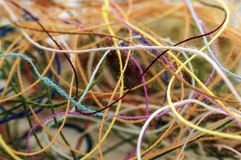 Multi-colored tangled colorful needlecraft silk thread rope. Mac stock photos