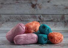 colorful yarns for knitting handmade clothes lies on a light background. royalty free stock images
