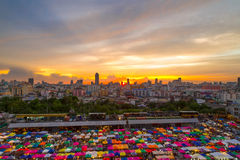 Multi-colored tents of train night market in Bangkok Stock Photos
