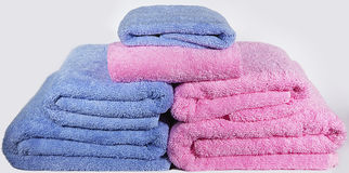 Multi-colored terry towels for bathrooms. Multi-colored terry towels for bathrooms stock images