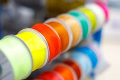 Multi-colored textile ribbons in hand-made reels displayed for sale in the store.  royalty free stock photos