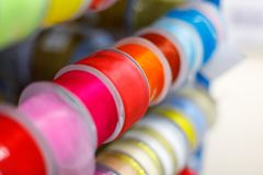 Multi-colored textile ribbons in hand-made reels displayed for sale in the store.  stock photography