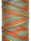 Multi-colored thread. A roll of brightly colored sewing thread royalty free stock photos