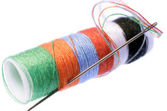 Multi colored thread. And needle stock photos