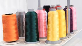 Multi-colored thread roll.Computerized embroidery machines. Colorful reels of threads. BackgroundMulti-colored thread roll.Computerized embroidery machines stock photos