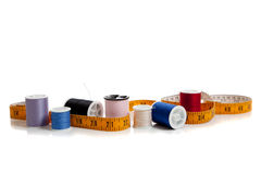 Multi colored thread with tape measure Stock Images