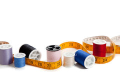 Multi colored thread with tape measure Royalty Free Stock Photos