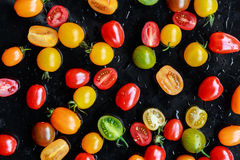 Multi-colored tomatoes Stock Images