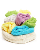 Multi-colored towels. Multi-colored Terry towels in wattled container  on white background Stock Images