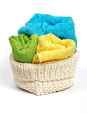 Multi-colored towels. Multi-colored Terry towels in wattled container  on white background Royalty Free Stock Image