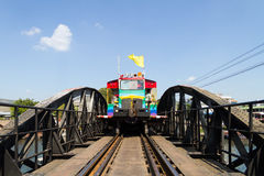 Multi-colored train. The color of the railway bridge over the River Kwai, Thailand Castrol Royalty Free Stock Image