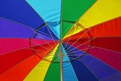 Multi-Colored Umbrella. Underneath a brightly colored umbrella in the rain royalty free stock photos