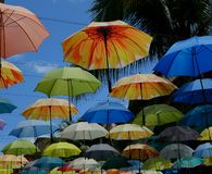 Multi-colored umbrella in the blue sky. To protect from the sun Royalty Free Stock Images