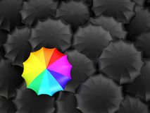 Multi-colored umbrella stands out Royalty Free Stock Photo