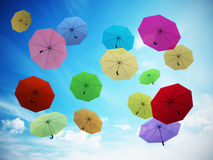 Multi colored umbrellas against blue sky. 3D illustration Royalty Free Stock Images