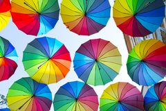Multi-colored Umbrellas Background. Colorful Umbrellas Floating Above The Street. Street Decoration. Royalty Free Stock Images