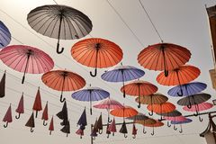 Multi Colored umbrellas hanging against the sky background, Yazd Stock Photography