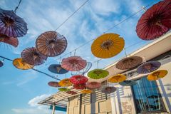 Multi-colored umbrellas hung on decorative wire to decorate the royalty free stock image
